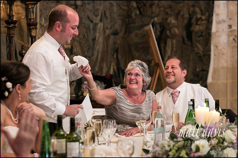 Mum passes the groom a tissue during wedding speeches at Berkeley Castle