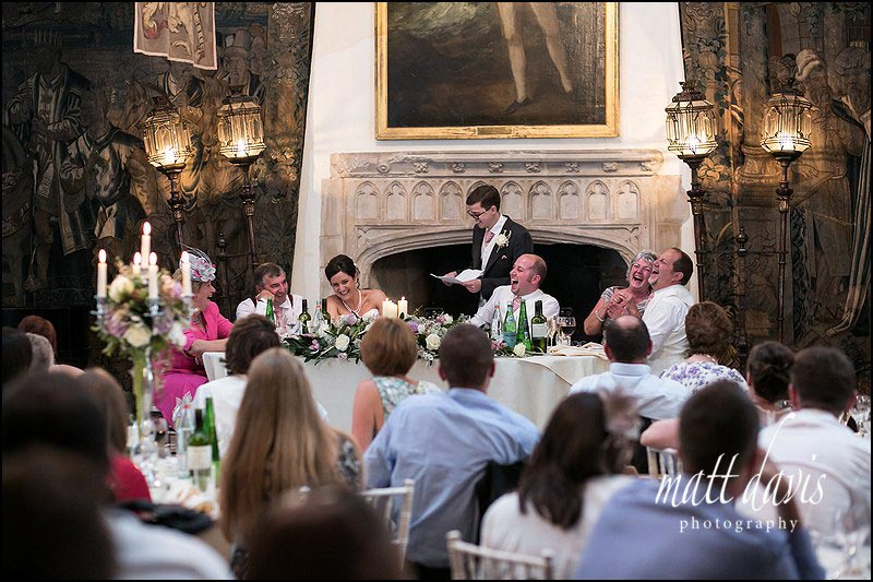 Documentary wedding photography in the great hall at Berkeley Castle during wedding speeches