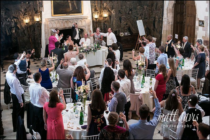 Documentary wedding photography at Berkeley Castle taken showing the great hall during wedding speeches