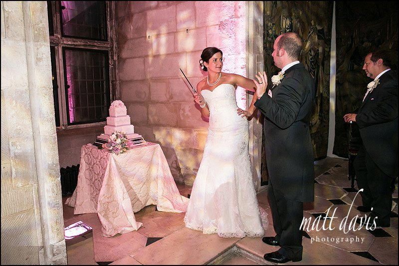 wedding cake cutting with bride threatening knife at groom