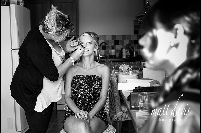 Bianca Gwilliam having make-up applied before her wedding day
