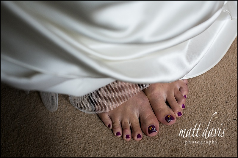 Bride with purple panted toe nails