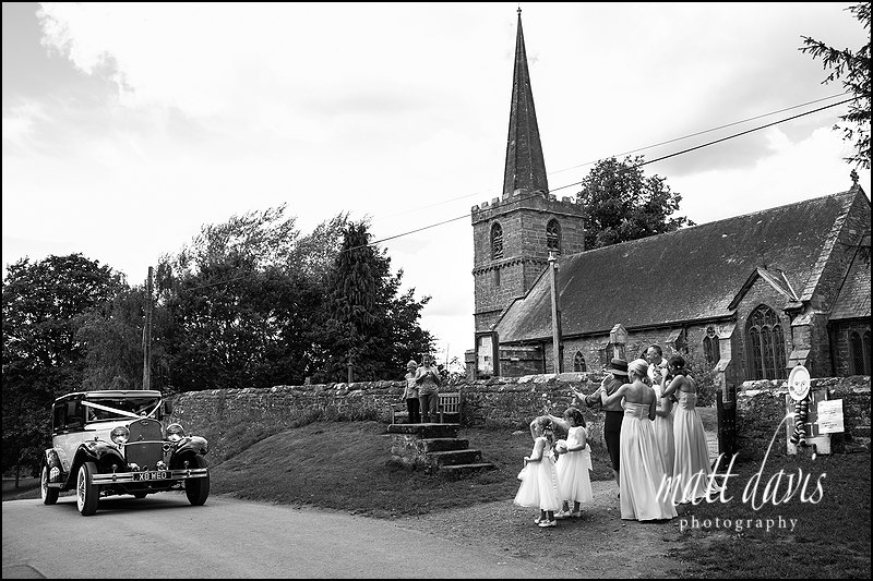 Brides arriving in wedding car at  St John The Baptist, Kings Caple, Herefordshire.