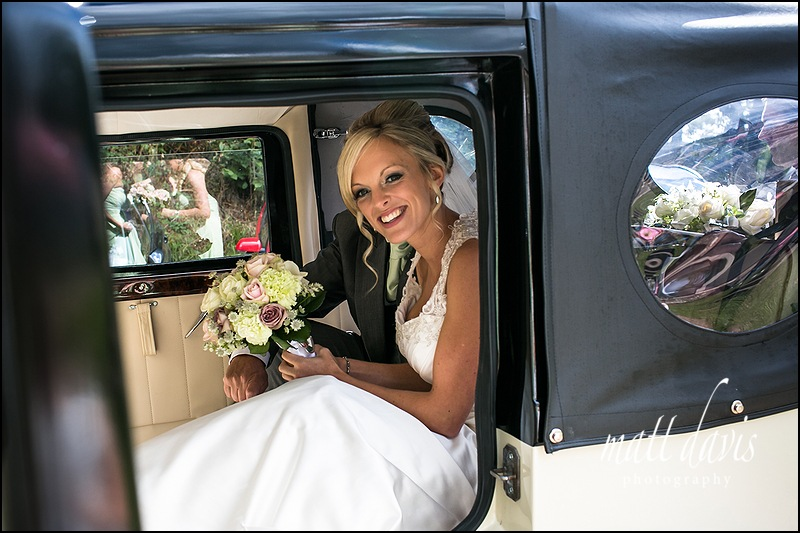 Brides arrival in wedding car at  St John The Baptist, Kings Caple, Herefordshire.