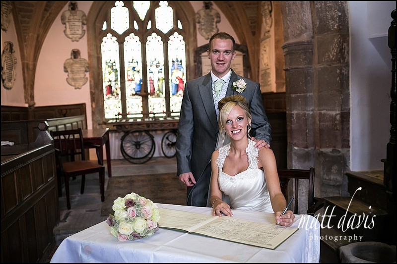 Bianca and Simon Gwilliam sign the wedding register as a newly married couple