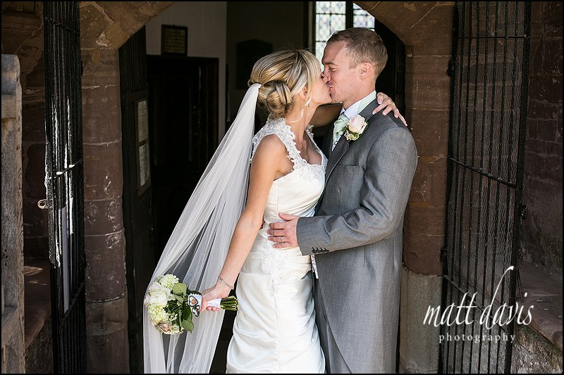 Wedding couple kiss before leaving church off to Caradoc Court for wedding photos