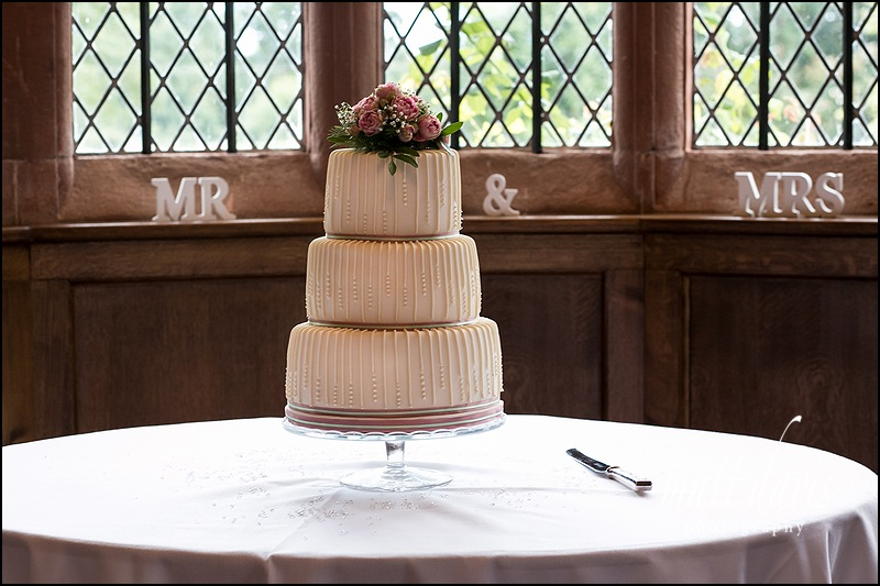 Elegant wedding cake in the window of Caradoc Court.  Photo taken by Matt Davis Photography.