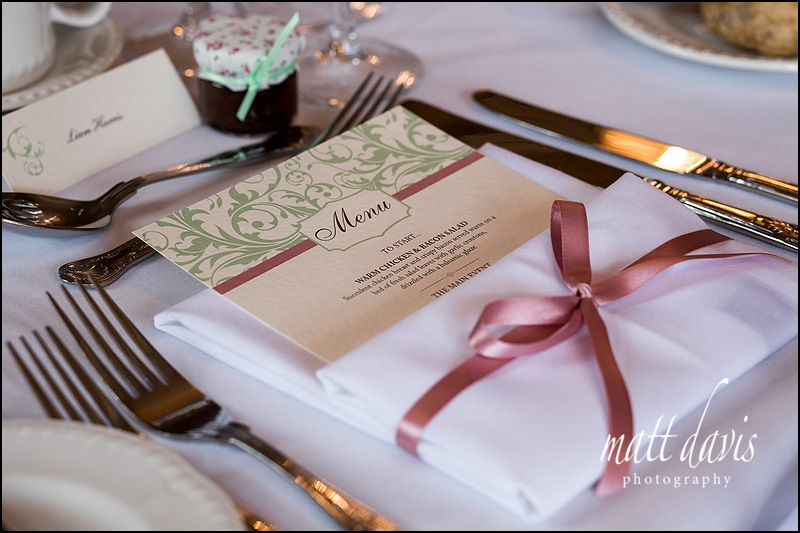 simple stylish wedding details with menu and napkin tied with pink ribbon