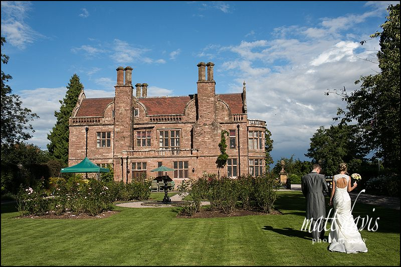 Wedding photos at Caradoc Court with the couple in the rose gardens