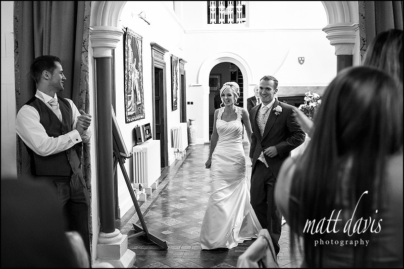 wedding couple entering the wedding breakfast at Caradoc Court