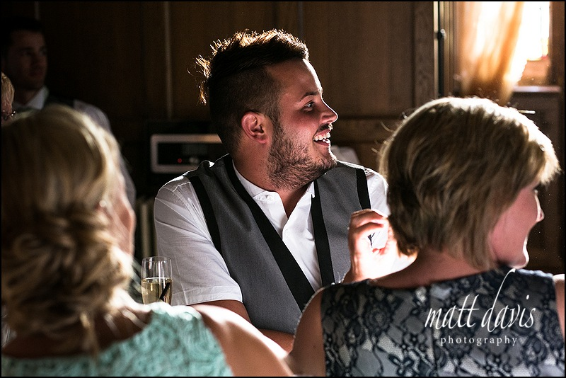 Guests laughing during a wedding at Caradoc Court