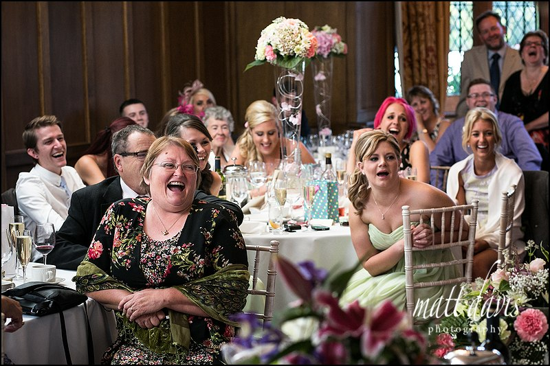 Wedding guests at tables laughing during wedding speeches at Caradoc Court