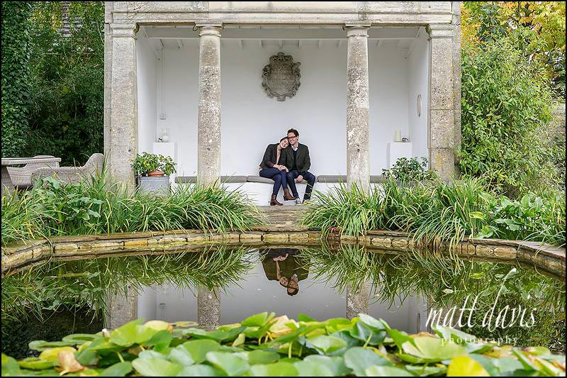 Engagement photo near the ornamental pond at Barnsley House near Cirencester, Gloucestershire