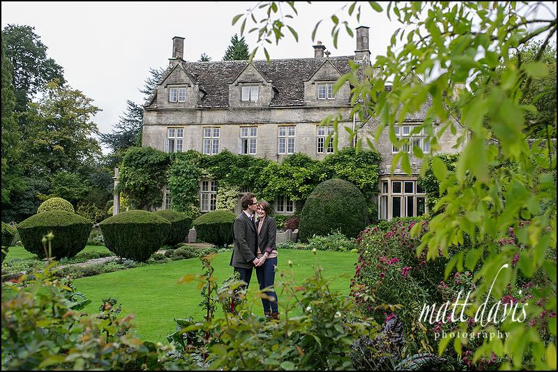 Couple standing outside Barnsley House in Gloucestershire