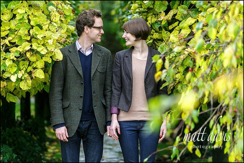 A quirky engagement Photo taken in the gardens of Barnsley House Gloucestershire by Matt Davis Photography