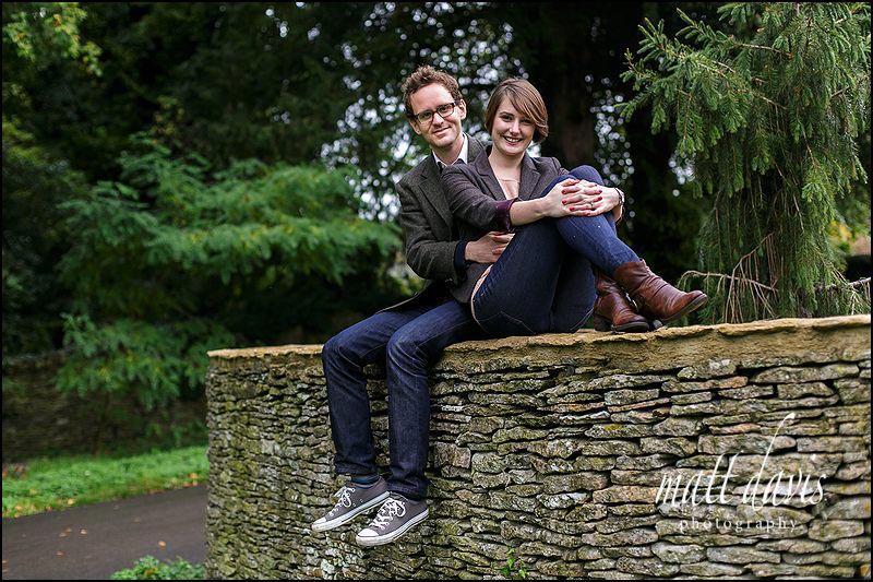 photos at Barnsley House, Gloucestershire of couple sat on wall outside