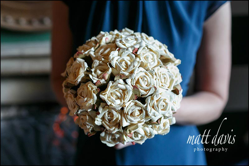 unique wedding flowers where the whole bouquet creates a round shape with delicate vintage looking off white roses