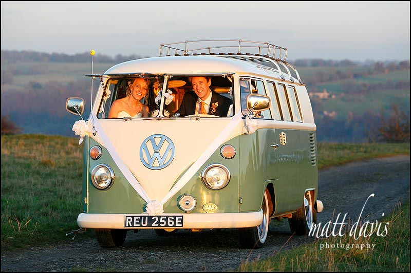 fun wedding photo of couple in Camper Van on Rodborough Common, Gloucestershire