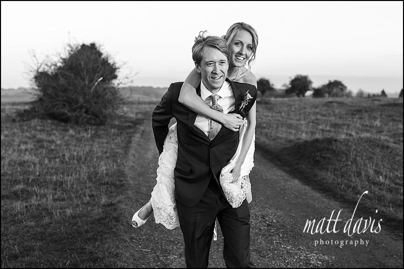 fun natural wedding photo of couple on Rodborough Common, Gloucestershire