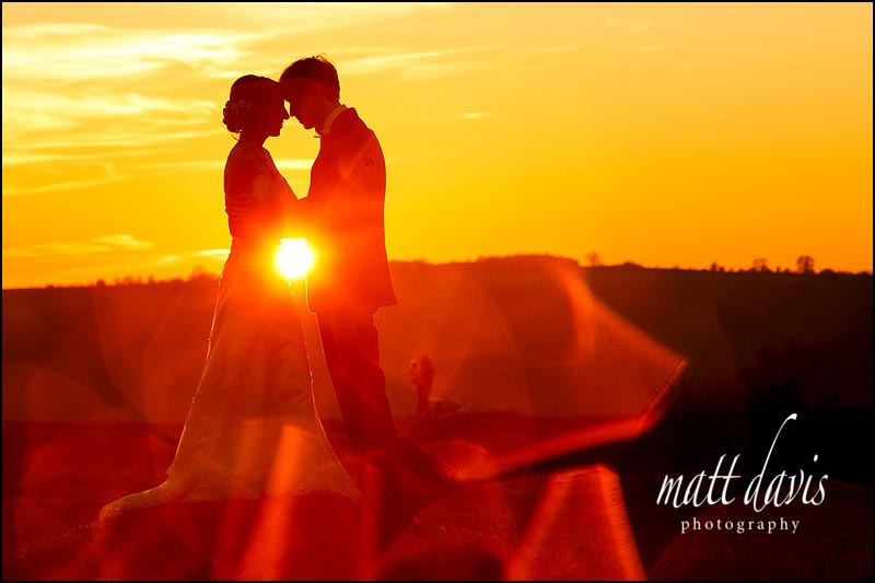 amazing sunset wedding photo taken on Rodborough Common for a couple who had their wedding at The Bear of Rodborough