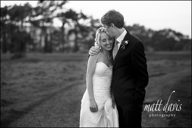 romantic black and white wedding photo of couple on Rodborough Common