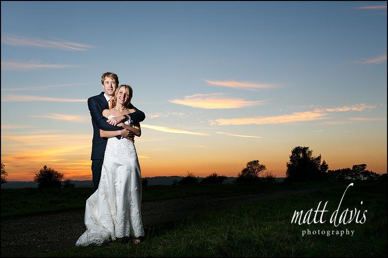 outdoor creative flash wedding photo of couple on Rodborough Common