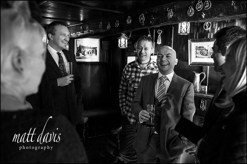 Groom drinking in the pub before his wedding at Limpley Stoke Hotel