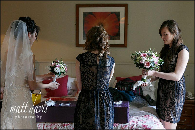 Bride and bridesmaids drying wedding flowers