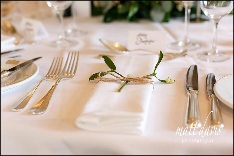 napkin ties with Mistletoe - a great touch for a Christmas wedding