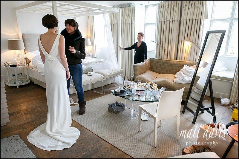 Beautiful backless wedding dress photo during bridal preps at a Winter wedding at Barnsley House