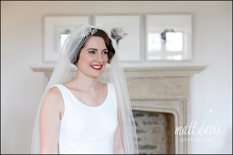 Portrait of bride with short hair, 20's hair piece and wedding veil