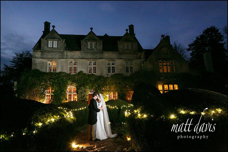 A winter wedding at Barnsley House bride and groom portrait taken at dusk