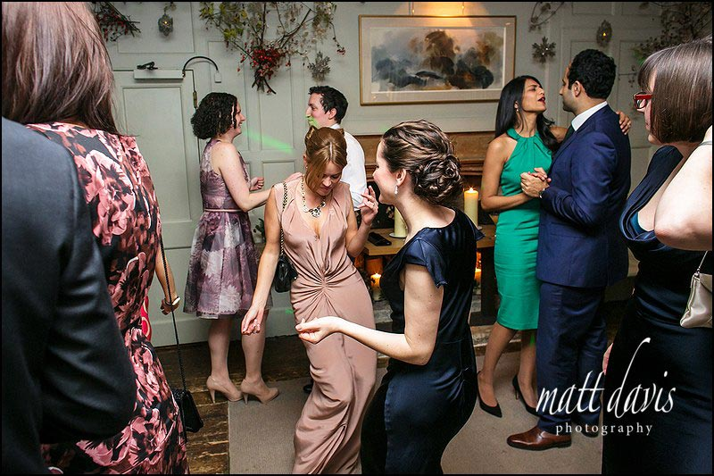 Guests on the dance floor at a Barnsley House wedding