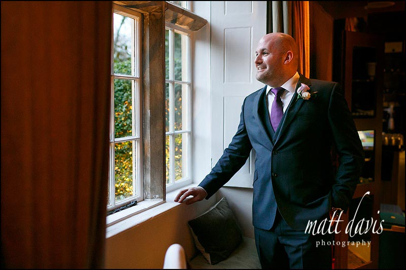 A daylight lit portrait of James the groom in the window at Barnsley House