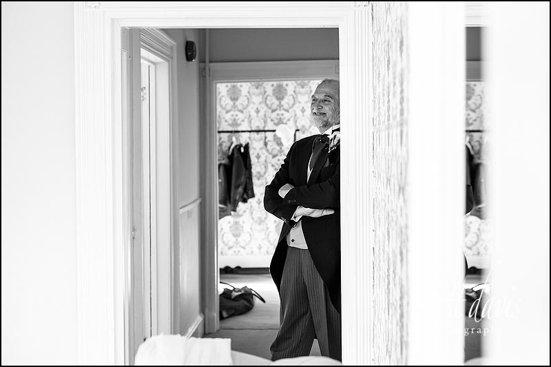 Documentary wedding photography capturing when father of the bride first see's the bride