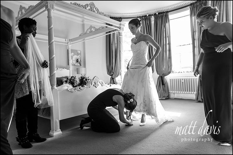 Bride in the bridal suite preparing for her wedding day at Eastington Park