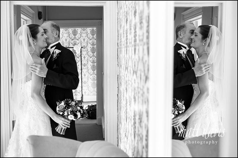Documentary wedding photography capturing when father of the bride and bride first meet