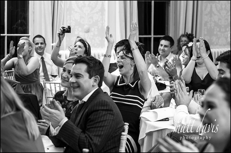 Guests reactions during speeches at an Eastington Park wedding