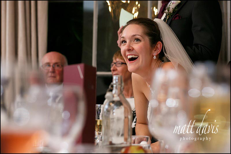 Brides reaction during speeches at an Eastington Park wedding