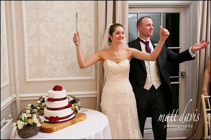 Bride and groom cutting the wedding cake at Eastington Park