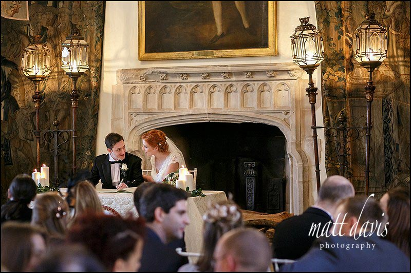 bride and groom signing the wedding register at Berkeley Castle during a civil ceremony