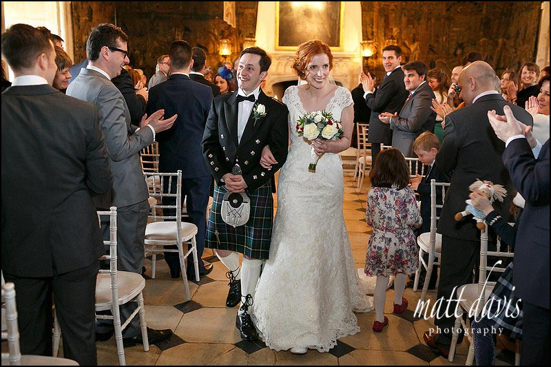 bride and groom leaving the main hall at Berkeley Castle after a civil ceremony