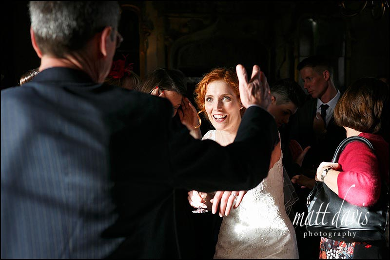 Documentary wedding photography of bride on her wedding day greeting guests