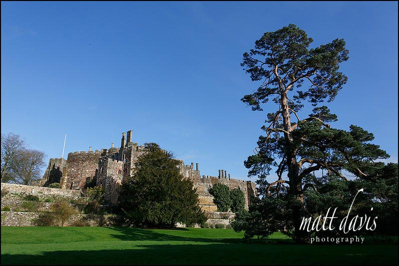 A winter wedding at Berkeley Castle with a bright blue sky
