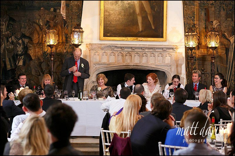 top table wedding guests laughing during speeches at Berkeley Castle, Gloucestershire