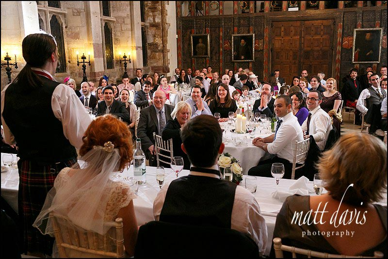 wedding guests smiling during speeches at Berkeley Castle, Gloucestershire