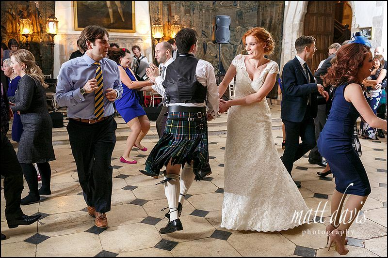 scottish ceilidh dancing during a winter wedding at Berkeley Castle