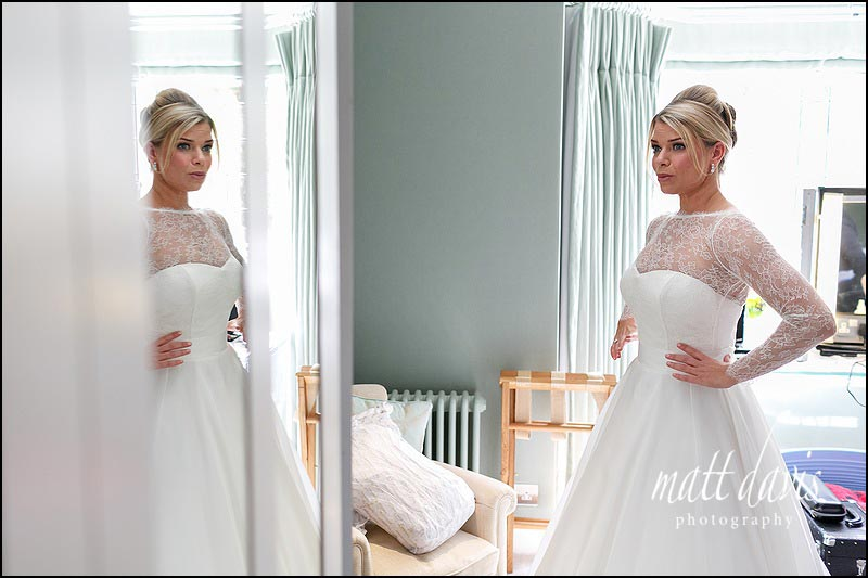 Emotional moments as a bride prepares for her wedding at Barnsley House, Gloucestershire