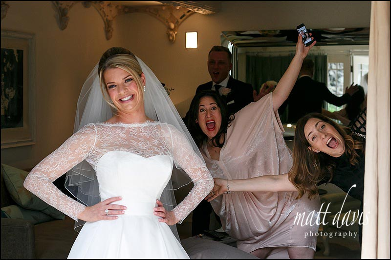 Fun moments as a bride prepares for her wedding at Barnsley House, Gloucestershire