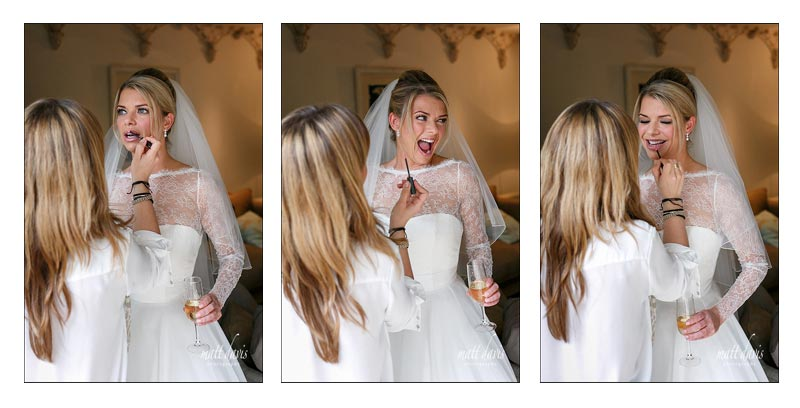 Fun moment as a bride has her final make-up touches completed before marrying